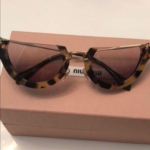 f6e2833b692c Miu miu tortoiseshell sunglasses cat eye gold
